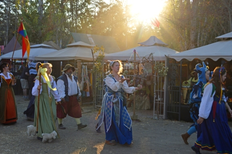 A woman juggles during the closing parade of the Northern California Renaissance Faire