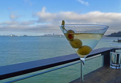 A martini at the Barrelhouse in Sausalito, California, set against the skyline of Sausalito, the San Francisco Bay and the city of San Francisco.